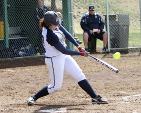 by: Kelly Caleb SMACK ATTACK — Tualatin grad Janelle Cromie gets her bat on the ball during an OIT game this season.