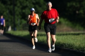 by: Jaime valdez Ted Zetterberg (184) holds his own with a runner while competing in a recent race-walk event at Clackamas Community College. The retired Rex Putnam High School teacher and coach has taken up competitive race-walking at 78.