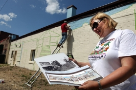 by: Jaime Valdez Beaverton Historical Society Vice President Bev Ecker holds up the rendering of a mural she plans to complete on the back of the society's building, which was inspired by old photos of downtown.