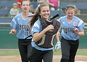 by: Miles Vance GOOD TIMES – Willow Creek catcher Emily Preble (center) leads teammates Emma Gordon (left) and Maddie Raleigh off the field after their team's Sunday victory over Lombardia Little League.