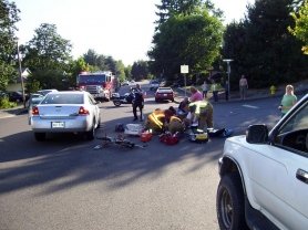by: Submitted Police and firefighters respond to a bicycle-car crash at Rockridge and Imperial drives Wednesday evening. The bicyclist, an 8-year-old boy, was injured but is expected to make a full recovery.