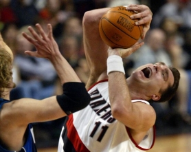 by: L.E. BASKOW Arvydas Sabonis draws a foul from Dirk Nowitzki of Dallas during a 2003 Trail Blazers playoff game.