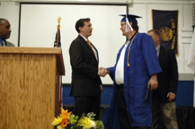 by: Jeff Spiegel State Rep. Patrick Sheehan congratulates a Job Corps graduate as he walks across the stage Aug. 17.