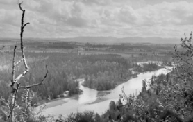 by:  This old photo from the Oregon State Highway  Department offers a view toward the southeast, where the area on the right of the Clackamas River was set aside for Clackamas County's first state park, along the south bank of the river.