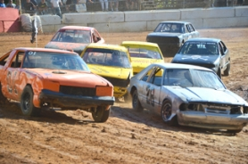 by: John Brewington MINI STOCK—St. Helens' Brad Beehler leads the pack during the second heat of the 4-cylinder division on Saturday night at River City Speedway.