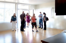 by: Jim Clark Visitors tour a three bedroom, two bath apartment at Human Solutions' new Rockwood Building during an open house on Thursday, Aug. 18. The building will bring new affordable housing and extensive social services to an area that is significantly underserved.