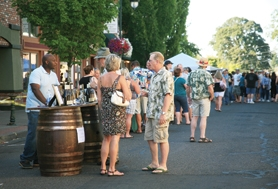 by: Photo courtesy of Brenda Somes Bertony Faustin, of Abbey Creek Vineyard, had a steady stream of vinophiles at his tasting table during last Saturday's Forest Grove UnCorked festival on Main Street.