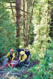 by: Photo courtesy of Forest Grove Fire & Rescue Forest Grove firefighters pull Peter Rowan to safety after his car plummeted off of a 120 foot embankment.