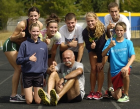 by: David Ball Members of Babson's Army gather around long-time Bruins' cross country coach Jim Babson, front middle, after a practice run earlier this week. The school has been taking part in the Hood-to-Coast event since 1995.