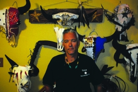 by: Stover E. Harger III SURROUNDED BY SKULLS — Dan Halstead stands in front of a wall showcasing some of his Spirit Skull designs. His St. Helens home is filled with the decorated buffalo skulls and some in-progress pieces.