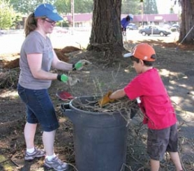 by: Contributed photos East Hill Church volunteers Joy and Timothy Fuentes clean-up the grounds at Gresham High School.