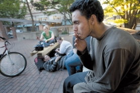 by: CHRISTOPHER ONSTOTT Estevan, 15, who had his first cigarette at age 8, smokes with friends in O'Bryant Square. Federal statistics show that Oregon is one of the easiest places in the country for youth to illegally buy cigarettes.