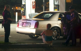 by: CHRISTOPHER ONSTOTT Portland police detain and question a prostitute on Northeast 82nd Avenue, an example of the higher workload on the east side that requires more money to keep call response times equal across the city.