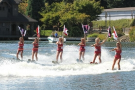 by: TOM SWINFORD Fun in the sun and water was a big factor in the success of the 2011 OHC Car-Boat Show. The Lake Oswego Water Ski Moms make a spectacular entrance at Lakewood Bay