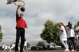 by: Jaime Valdez Former Trail Blazers great Arvydas Sabonis slam dunks a basketball Veronica Decker, 6, fired toward the hoop at Eichler Park.