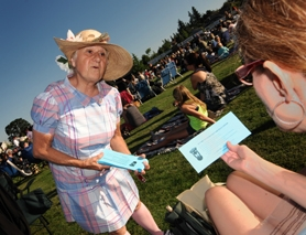 by: Vern Uyetake Alice Richmond of West Linn – a member of a political action committee rallying for a new station for the West Linn Police Department – passes out fliers at a concert at Tanner Creek Park encouraging voters to pass a bond measure in November.
