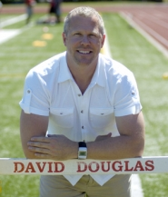 by: David Ball Bob Gray poses with a hurdle at the David Douglas track where he has spent the last 18 years as a teacher at his alma mater.