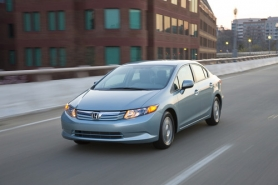 by: Honda Motor Co. Honda redesigned the 2011 Civic but did not change its basic character.