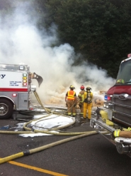 by: Tualatin Valley Fire and Rescue Interstate 205 northbound lanes between Interstate 5 and Stafford Road remains closed this afternoon while Tualatin Valley Fire & Rescue firefighters continue to extinguish a hay truck fire that occurred earlier this morning.