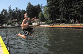 by: vern uyetake Thomas Boe, 11, cooled off last week by taking a plunge into the lake at the swim park in Lake Grove.