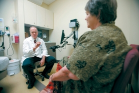 by: CHRISTOPHER ONSTOTT Dr. Bob O'Rourke consults with Sharon Rollins about her upcoming gastric bypass surgery at OHSU. O'Rourke says most of his patients cannot address their obesity through diet and exercise – no matter how hard they try.