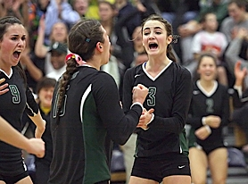 by: Miles Vance READY FOR MORE — Jesuit's Megan McCool (right) is back to lead the Crusaders in search of their 14th straight Metro League championship.