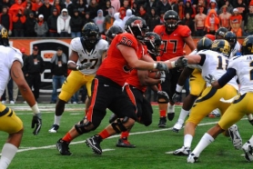 by: ERIK DRESSER Oregon State's Mike Remmers (right) wards off an opposing defensive lineman.