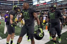 by: JAIME VALDEZ LaMichael James gets his Oregon Ducks teammates pumped up at Cowboys Stadium before Saturday's season opener against LSU.