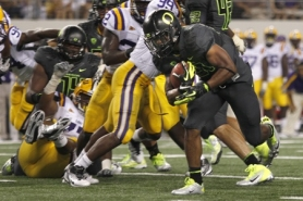 by: JAIME VALDEZ LaMichael James scores a first-half touchdown for the Oregon Ducks, who led for a while in the first half Saturday before falling to LSU 40-27 in the Cowboys Classic at Arlington, Texas.