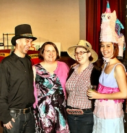"by: David F. Ashton Getting ready for the SCRAP Rebel Craft Rumble are organizer Jon Toorock; Janet Strahl, secretary of their board; ""Craft Cop"" and staff member Jenn Alvin; and volunteer raffle ticket seller ""Chrissy Pretty-Piñata"", a/k/a Sarah Dyer."