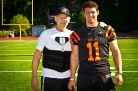 by: COURTESY OF MICHAEL WORKMAN Shawn Evans, star receiver for Lewis & Clark College, shares precious moments between and during games with his father, Butch, who has been battling cancer for six years.