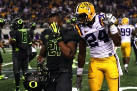 by: JAIME VALDEZ LSU's Tharold Simon (right) heckles Oregon running back LaMichael James after the Tigers tackled him in the fourth quarter of last week's game in Arlington, Texas.