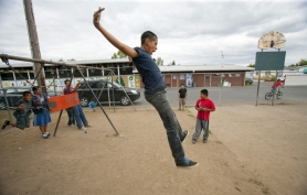 by: Christopher Onstott Joel Zavalza, 12, leaps from a swing while hanging out at the Wood Village Green, one of three mobile home parks in the community, where many Latino families have managed to buy their first homes. Wood Village now tops Portland-area cities for diversity.