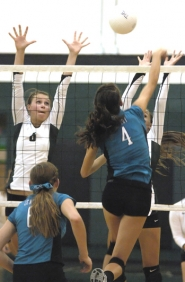 by: DAN BROOD GOING UP — Tigard's Bonnie Blood (left) and Valerie Hughes reach up in an attempt to block a shot by Century's Raquel Mellick in Tuesday's match.