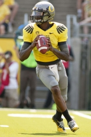 by: CHRISTOPHER ONSTOTT Oregon Ducks QB Darron Thomas drops back to pass Saturday versus Nevada.
