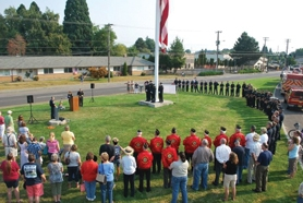 by: Courtesy of Forest Grove Fire & Rescue More than 100 people attended a 9/11 memorial service Sunday morning in Forest Grove. As part of the ceremony, Forest Grove Firefighter Ted Penge presented Chief Michael Kinkade with a 9/11 memorial coin and photo album as a gift from the International Association of Firefighters Union. More photos are posted on the Forest Grove Fire & Rescue's facebook page.