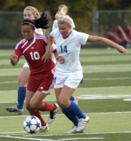 by: David Ball Barlow's Kayley King, 14, battles for the ball with Centennial's Tara Phanakhone.