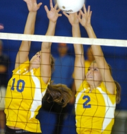 by: David Ball Barlow's Meg Marlett, 10, and Danelle Woodcock work for a block Tuesday night.