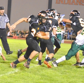 by: John Brewington ON THE MOVE—Scappoose's Grayson Schillereff finds a hole and big yardage during Friday's game against North Marion. The Indians posted a 51-12 win.