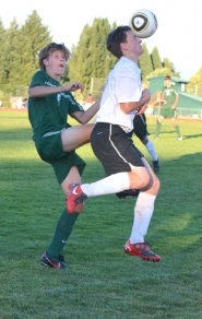 by: John Brewington SOCCER FEATS—Scappoose's Alex Lukinbeal meets the ball with his head during last week's match with Estacada.