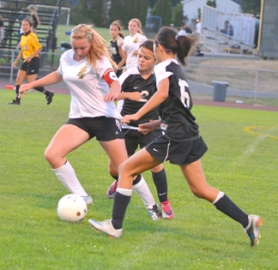 by: John Brewington SOCCER MOVE—St. Helens' Chelsee Rennie clears the ball during a match with Southridge last week.