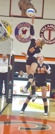 by: John Brewington UP HIGH—Scappoose's Lexine Loos skys for a kill during last week's match against Madras.