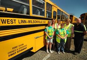 by: VERN UYETAKE From left: Carol Hoeger, Brenda Morris, Dawn Buchanen, Darelle Brace, Irene Whittaker and Don Allen share a First Student bus that operates in the West Linn-Wilsonville School District – staffed by the safest bus drivers in the Northwest.