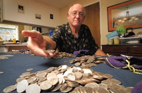 by:  VERN UYETAKE It took West Linn's Paul Dempsey 10 years to collect 2,753 New York state quarters in honor of the victims of the Sept. 11, 2011 terrorist attacks. And now that his collection is complete, Dempsey said he will donate the money to a cause in West Linn.