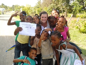 "by: submitted photo Sierra Green, above center, spent eight weeks in the Dominican Republic teaching ""campamentos,"" or summer camp to children."