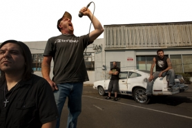 by: CHRISTOPHER ONSTOTT Steve Lewis, vocalist for Portland metal band Betrayed by Weakness, emotes in a parking lot while guitarist Reuben Valdez (left), drummer Tim Huber and bassist Adam Clausen (right) silently contemplate wreaking musical havoc.
