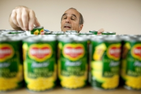 by: CHRISTOPHER ONSTOTT Kevin Deneen stocks cans of corn at SnowCap, the largest food pantry in Multnomah County, which provides emergency food help to as many as 180 needy families a day. And more are coming in each month.