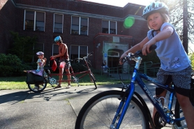 "by: JAIME VALDEZ Laurie Paulsen, a parent at North Portland's Beach School, encourages families to get on the ""bike train"" to and from school. Her children, Alina (right) and Anya Armstrong, are among the 40 percent of Portland students who make at least most of their trips to school by bike or on foot."