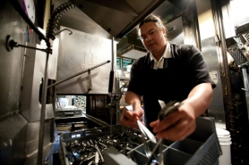 by: CHRISTOPHER ONSTOTT Five days a week, Jason Woo washes dishes at McMenamins Kennedy School. He's struggled past his diagnosis of schizoaffective disorder to find work through the state's Office of Vocational Rehabilitation.