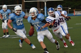 by: VERN UYETAKE Above, Lakeridge's Blake Dutton runs back a punt for a touchdown in Friday's win over Aloha. It marked Lakeridge's fourth special teams touchdown this year and the third scored by Dutton. Below, Lakeridge's Spencer Russell gets pulled down by the facemask in the team's win.